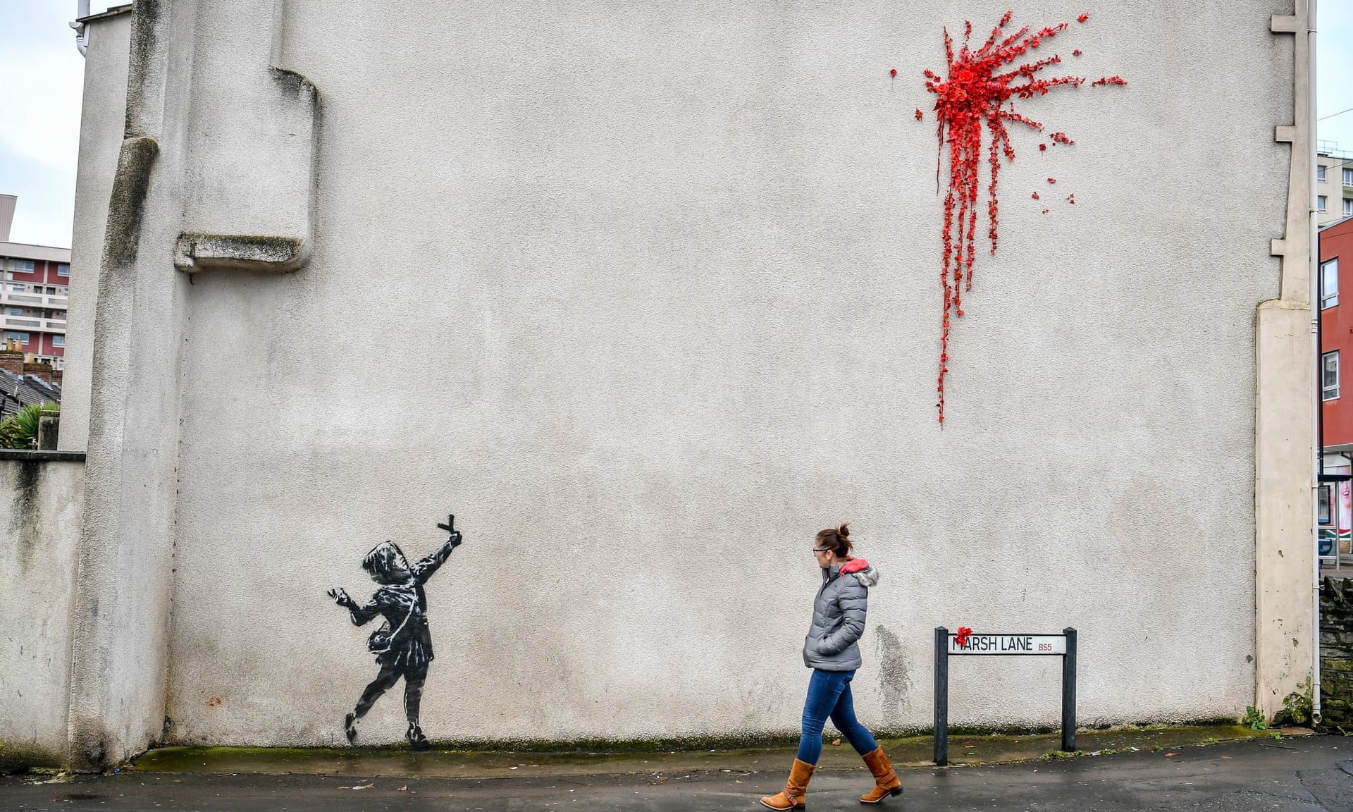 Banksy, the elusive street artist from Bristol, is believed to be behind the artwork on the side of a house in the city's Barton Hill district. Photograph: Ben Birchall/PA